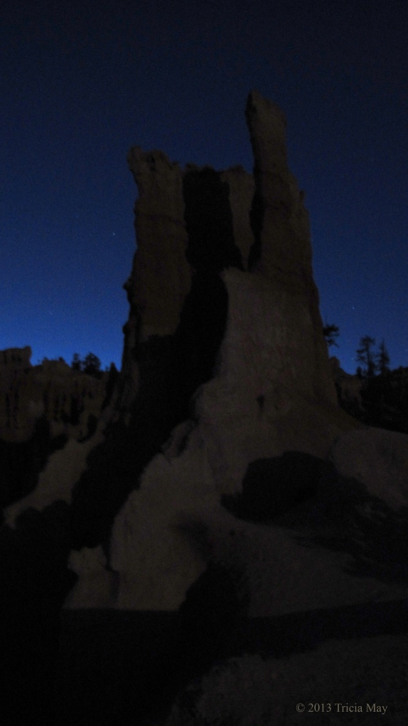 Hoodoo lit by moonlight